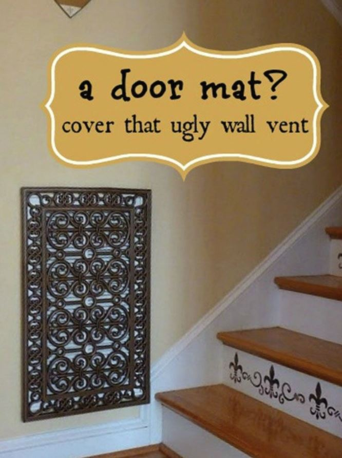A doormat being used to cover ugly air vent
