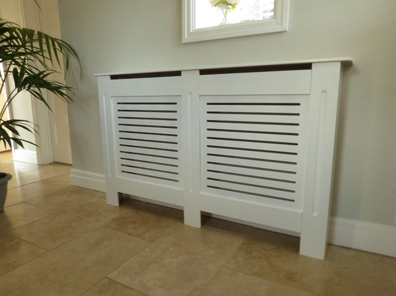 Radiator cover adapted to cover pex manifold plumbing