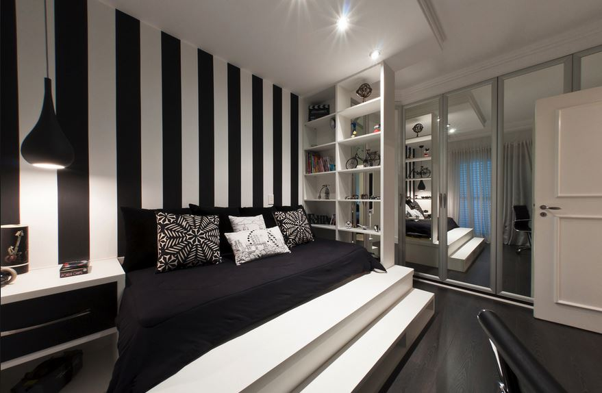 Black and white striped bedroom with storage